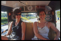 Jamie and Kim riding in a jeepney to the Krabi Airport