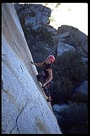 Chris Williamson leading a Josh classic, Solid Gold  (5.10a). Joshua Tree NP, California
