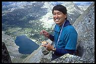 David Oka showing his resourcefullness eating a can of tuna with his nut tool. Wind River Range, Wyoming
