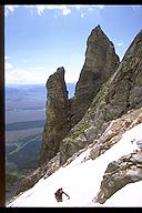 Ian Springsteel hiking past the Idol and the Worshiper on Teewinot, Grant Teton NP, Wyoming