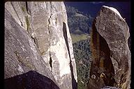 The fun doesn't end when the climbing stops on the Lost Arrow Spire. David Benson doing the tyrollean traverse back to the valley rim. Yosemite, California